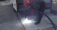 Lift Gate on Box Truck Being Sprayed with Thermion SafTrax TH604 Non-Skid